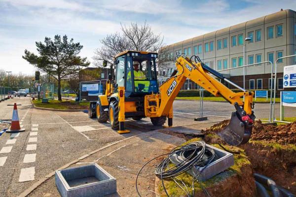 3CX backhoe loader digging up earth